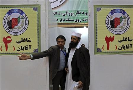 A member of a traditional Afghan grand assembly convened to debate matters of national importance known as a ''Loya Jirga'' arrives to be registered for an upcoming meeting in Kabul November 17, 2013. REUTERS/Omar Sobhani