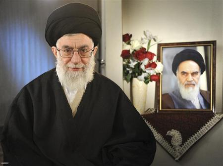 EDITORS' NOTE: Reuters and other foreign media are subject to Iranian restrictions on their ability to film or take pictures in Tehran. Iran's Supreme Leader Ayatollah Ali Khamenei sits next to a portrait of late leader Ayatollah Ruhollah Khomeini while taking part in a television live programme in Tehran on the occasion of the Iranian New Year March 21, 2011. REUTERS/Leader.ir/Handout
