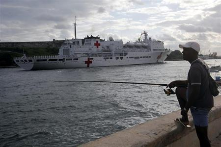 A fisherman looks at Chinese navy hospital-ship ''Peace Ark'', as it enters the bay of Havana October 21, 2011. REUTERS/Stringer/Files