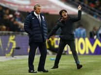 Germany's coach Joachim Loew (R) celebrates nex to England's manager Roy Hodgson after their international friendly soccer match at Wembley Stadium in London November 19, 2013. REUTERS/Eddie Keogh