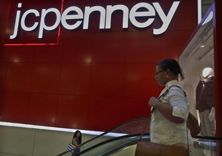 Customers ride the escalator at a J.C. Penney store in New York August 14, 2013. REUTERS/Brendan McDermid