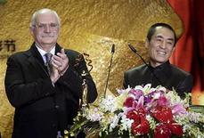 Russian director Nikita Mikhalkov (L) and Chinese director Zhang Yimou present the Tiantan Award of Best Film during the closing ceremony of the 3rd Beijing International Film Festival in Beijing April 23, 2013. REUTERS/Stringer