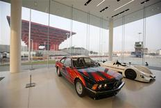 Cars are seen inside the BMW Experience Center in Shanghai November 19, 2013. REUTERS/Aly Song