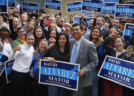 San Diego mayoral candidate and City Councilman David Alvarez and wife Xochitl (C) hold an election day rally before his campaign workers mobilize to get the vote out in a special election for mayor in San Diego, California November 19, 2013. REUTERS/Mike Blake