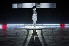 "Lady Gaga prepares to fly with the Volantis, a flying dress, at the ""artRave"" release event of her new album ""ARTPOP"" in New York November 10, 2013. REUTERS/Andrew Kelly"
