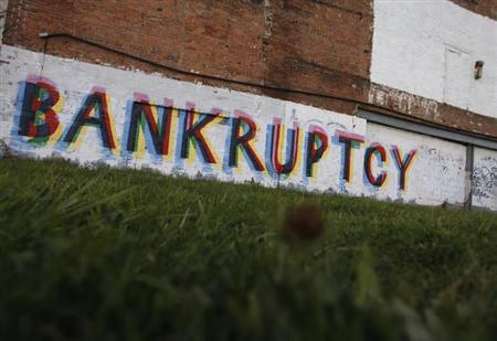The word ''Bankruptcy'' is painted on the side of a building in Detroit, Michigan October 25, 2013. REUTERS/Joshua Lott