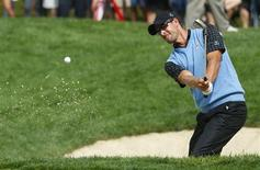 Adam Scott of Australia hits from the sand on the 14th hole during his match against Bill Haas of the U.S. during the Singles matches for the 2013 Presidents Cup golf tournament at Muirfield Village Golf Club in Dublin, Ohio October 6, 2013. REUTERS/Jeff Haynes