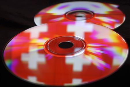 Compact discs with images of the Swiss flag are seen in this photo illustration taken in the central Bosnian town of Zenica, May 3, 2013. REUTERS-Dado Ruvic