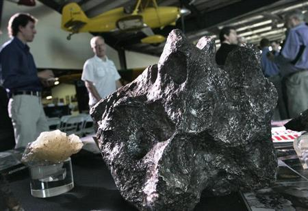 Meteorites sit on a display table at the Deep Space Industries announcement of plans for the world's first fleet of commercial asteroid-prospecting spacecraft at the Museum of Flying in Santa Monica, California, January 22, 2013. REUTERS/Jonathan Alcorn