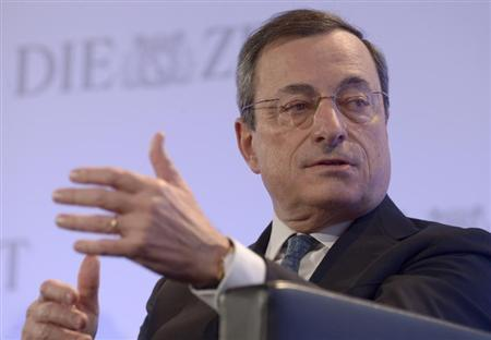 European Central Bank (ECB) President Mario Draghi gestures during his speech at the ''German Economic Forum'', organized by German weekly newspaper ''Die Zeit'', in the St.Michaelis church (nicknamed ''Michel'') in Hamburg, November 7, 2013. REUTERS/Fabian Bimmer