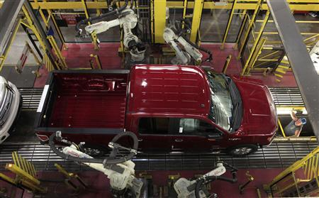 Robots do a quality control check of a 2014 Ford F-150 pick-up truck as it moves down the assembly line at the Ford Motor Dearborn Truck Plant in Dearborn, Michigan in this September 16, 2013 file photo. REUTERS/Rebecca Cook/Files