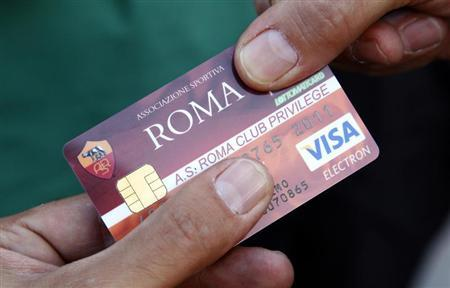 An AS Roma supporter shows his ID card before the start of the Italian Serie A football match against Cesena at the Olympic stadium in Rome August 28, 2010. REUTERS/Max Rossi