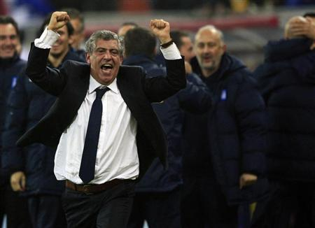 Greece's head coach Fernando Santos celebrates defeating Romania during their 2014 World Cup qualifying soccer match in Bucharest November 19, 2013. REUTERS/Radu Sigheti