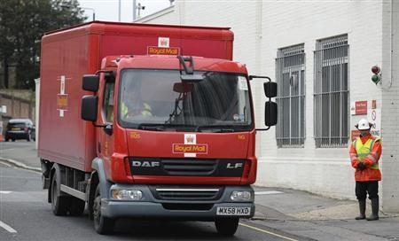 A Royal Mail truck drives past Mount Pleasant sorting office in central London, October 19, 2013. REUTERS/Paul Hackett