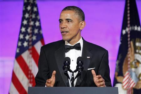 U.S. President Barack Obama delivers remarks at a dinner in honor of Presidential Medal of Freedom awardees at the Smithsonian National Museum of American History in Washington, November 20, 2013. REUTERS/Jonathan Ernst