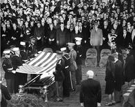 Mourners look on during the burial and folding of the flag ceremony for former U.S. President John F. Kennedy at Arlington National Cemetery, in this handout image taken on November 25, 1963. REUTERS/The White House