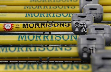 Shopping trolleys are seen parked at a Morrisons supermarket in north London March 14, 2013. REUTERS/Luke MacGregor