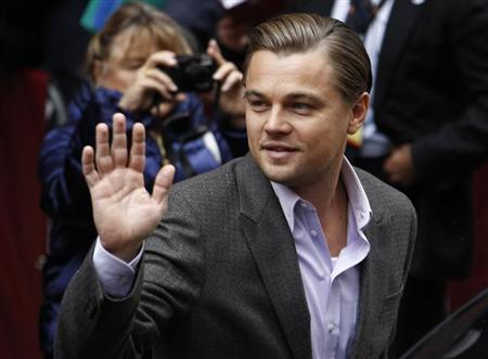 Actor Leonardo DiCaprio waves to supporters as he arrives for a photocall to promote the movie ''Shutter Island'' at the Berlinale International Film Festival in Berlin February 13, 2010. REUTERS/Fabrizio Bensch