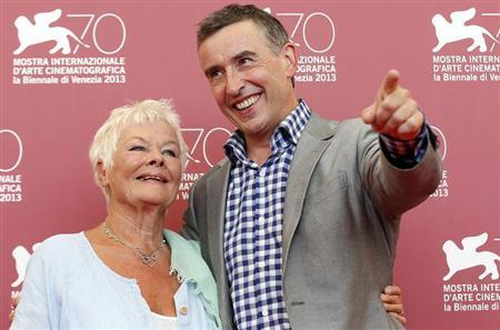Actors Judi Dench (L) and Steve Coogan (R) pose during a photocall for the movie ''Philomena'', directed by Stephen Frears, during the 70th Venice Film Festival in Venice August 31, 2013. REUTERS/Alessandro Bianchi