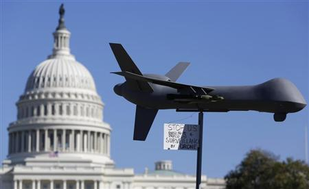 Demonstrators deploy a model of a U.S. drone aircraft at the ''Stop Watching Us: A Rally Against Mass Surveillance'' near the U.S. Capitol in Washington, October 26, 2013. REUTERS/Jonathan Ernst