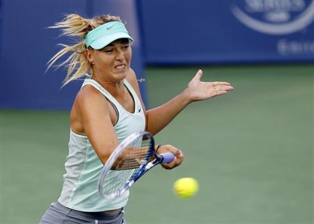Maria Sharapova of Russia hits a return to Sloane Stephens of the U.S. at the Women's Cincinnati Open tennis tournament in Cincinnati, Ohio August 13, 2013. REUTERS/John Sommers II