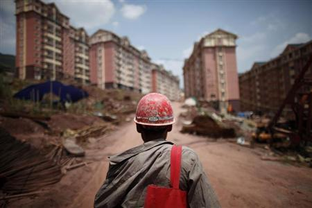 A labourer walks at a construction site where houses will be raised for people who will be relocated in Badong, on the banks of the Yangtze River, 100km (62 miles) from the Three Gorges dam in Hubei province August 7, 2012. REUTERS/Carlos Barria