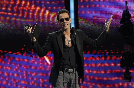 Marc Anthony accepts the award for record of the year for ''Vivir Mi Vida'' onstage during the 14th Latin Grammy Awards in Las Vegas, Nevada November 21, 2013. REUTERS/Mario Anzuoni