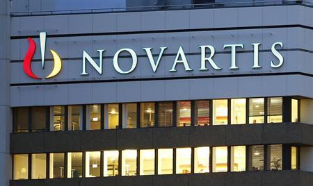 The logo of Swiss drugmaker Novartis is seen at its headquarters in Basel October 22, 2013. Novartis raised its full-year outlook for a second quarter in a row on Tuesday due to the ongoing absence of generic competition to its best-selling blood pressure pill Diovan. REUTERS/Arnd Wiegmann
