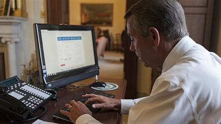 House Speaker John Boehner attempts to sign up for healthcare on the DC Health Link in Washington, in this handout photo courtesy of the Speaker of the House website on November 21, 2013. REUTERS/Speaker.gov/Handout via Reuters