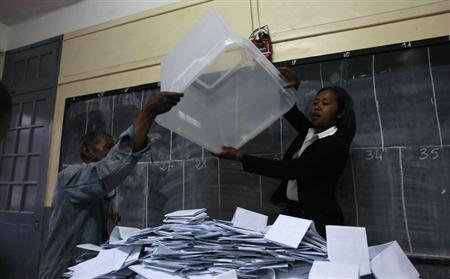 Electoral officials empty a ballot box before counting the cast votes at a polling center in the capital Antananarivo, October 25, 2013. REUTERS/Thomas Mukoya