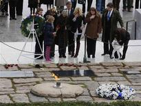 Members of the Kennedy family pay their respects at Arlington National Cemetery to mark the 50th anniversary of the assassination of former U.S. President John F. Kennedy at his gravesite in Arlington, November 22, 2013. REUTERS/Larry Downing