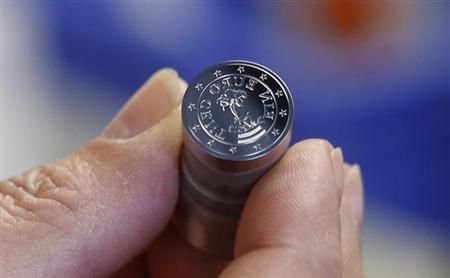 A one Euro cent coining die is seen in the Austrian Mint (Muenze Oesterreich) headquarters in Vienna April 23, 2013. REUTERS/Leonhard Foeger