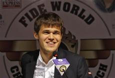 Norway's Magnus Carlsen smiles as he speaks with the media at a news conference after clinching the FIDE World Chess Championship in the southern Indian city of Chennai November 22, 2013. REUTERS/Babu