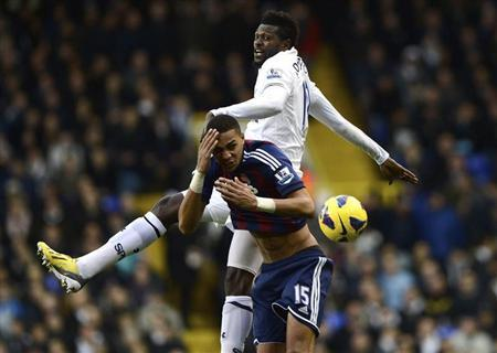 Tottenham Hotspur's Emmanuel Adebayor (R) challenges Stoke City's Steven N'Zonzi during their English Premier League soccer match at White Hart Lane in London December 22, 2012. REUTERS/Dylan Martinez