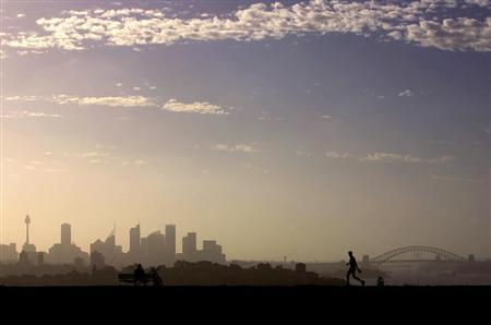 A man walks as another looks towards the city of Sydney on a hot summers day December 30, 2005. REUTERS/David Gray