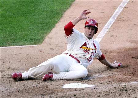 Oct 12, 2013; St. Louis, MO, USA; St. Louis Cardinals third baseman David Freese (23) scores a run against the Los Angeles Dodgers during the fifth inning against the Los Angeles Dodgers in game two of the National League Championship Series baseball game at Busch Stadium. Rob Grabowski-USA TODAY Sports