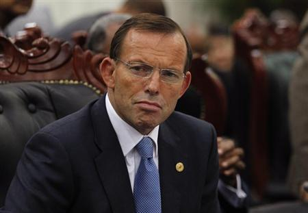 Australia's Prime Minister Tony Abbott attends a session of the Commonwealth Heads of Government Meeting (CHOGM) in Colombo, November 17, 2013. REUTERS/Dinuka Liyanawatte