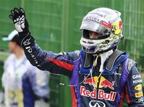 Red Bull Formula One driver Sebastian Vettel of Germany celebrates after taking pole position at the qualifying session of the Brazilian F1 Grand Prix at the Interlagos circuit in Sao Paulo November 23, 2013. REUTERS/Paulo Whitaker