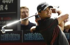 Australia's Jason Day plays a tee shot on the 12th hole during the final round of the World Cup of Golf at The Royal Melbourne Golf Club in Melbourne November 24, 2013. REUTERS/Brandon Malone