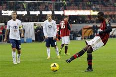 AC Milan's Mario Balotelli takes a penalty which was saved during their Italian Serie A soccer match against Genoa at San Siro stadium in Milan November 23, 2013. REUTERS/Alessandro Garofalo