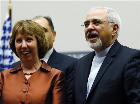 European Union foreign policy chief Catherine Ashton (L) smiles next to Iranian Foreign Minister Mohammad Javad Zarif during a ceremony at the United Nations in Geneva November 24, 2013. REUTERS/Denis Balibouse