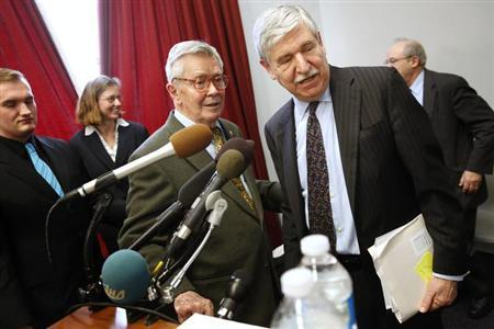 Ambassador Bruce Laingen (3rd L), who was the senior U.S. diplomat in Tehran when he and 51 others were taken prisoner in the Iranian hostage crisis in 1979, and Ambassador John Limbert (R), who served as the Deputy Assistant Secretary of State for Iran during the first Obama administration, wrap up a news conference calling for greater diplomacy between the U.S. and Iran, on Capitol Hill in Washington, February 25, 2013. REUTERS/Jonathan Ernst/Files