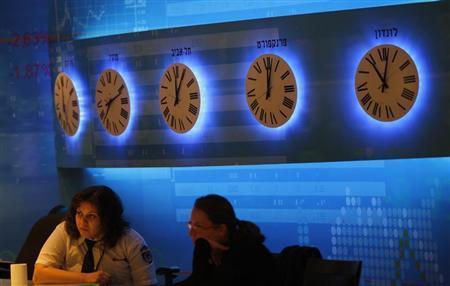 Workers sit inside the Tel Aviv stock exchange November 25, 2008. REUTERS/Gil Cohen Magen