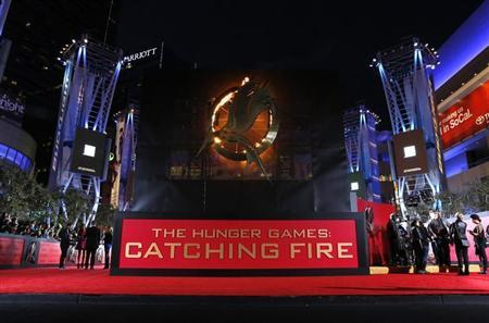 People wait at the premiere of ''The Hunger Games: Catching Fire'' in Los Angeles, California November 18, 2013. REUTERS/Mario Anzuoni