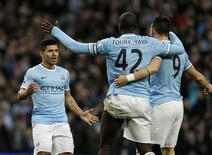 Manchester City's Sergio Aguero (L) celebrates his second goal with Yaya Toure (C) and Alvaro Negredo during their English Premier League soccer match against Tottenham Hotspur at the Etihad Stadium in Manchesterr, northern England November 24, 2013. REUTERS/Phil Noble
