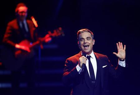 British singer Robbie Williams performs during the Bambi 2013 media awards ceremony in Berlin November 14, 2013. REUTERS/Tobias Schwarz