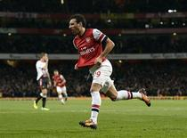Arsenal's Santi Cazorla celebrates after scoring a goal against Liverpool during their English Premier League soccer match at the Emirates stadium in London November 2, 2013. REUTERS/Dylan Martinez