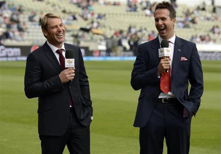 Former cricketers Shane Warne (L) of Australia and Michael Vaughan of England laugh as they commentate before the ICC Champions Trophy Group A match between England and Australia at Edgbaston cricket ground in Birmingham June 8, 2013. REUTERS/Philip Brown
