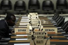 A delegate waits for the opening of a session of the Trade Negotiation Committee at the World Trade Organization (WTO) in Geneva July 22, 2013. REUTERS/Denis Balibouse