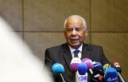 Egypt's Prime Minister Hazem el-Beblawi speaks during a news conference in Abu Dhabi October 27, 2013. REUTERS/Ben Job